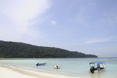 Sea and Boats on sand beach in Malaysia Stock Photo