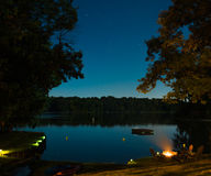 Sea Body of Water Near Trees during Nighttime Stock Photos