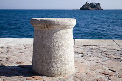 Sea bollard 1. Stone sea bollard on mooring line 1 Stock Photos