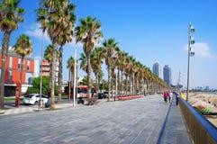 Sea boulevard of Barceloneta. Barcelona, Spain - September 25, 2014: People walk on the sea boulevard of Barceloneta near beach in summer sunny day Stock Image