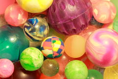 A sea of bouncy balls. Colorful bouncy balls draw attention as they rest together waiting to be played with royalty free stock images