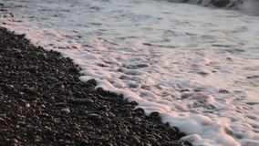 Sea Braking Against Stones And Pebbles On a Beach, Waves of Pure Water stock footage