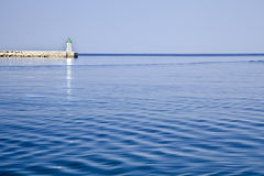 Sea breaker and ligthouse croatia Stock Photography
