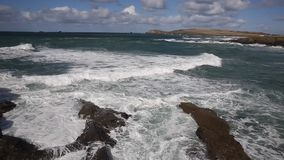 Sea breaking over rocks Porthcothan Bay Cornwall England UK Cornish north coast stock video footage