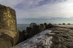 Sea breakwater. A breakwater on the Black Sea coast in winter royalty free stock photo