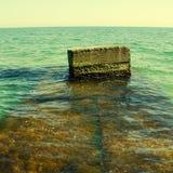 Sea breakwater Stock Images