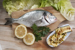 Sea bream and courgette Royalty Free Stock Image