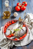 Sea bream/Dorado baked with tomato confit and a bouquet garni Royalty Free Stock Image