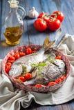 Sea bream/Dorado baked with tomato confit and bouquet garni Stock Photography