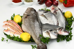 Fresh fish and vegetable on plate royalty free stock image