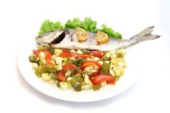 Sea Bream fish with vegetables on white plate. Isolated Royalty Free Stock Photo