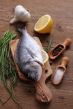 Sea Bream with ingredients on cutting board Royalty Free Stock Photos