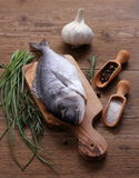 Sea Bream with ingredients on cutting board Royalty Free Stock Photo