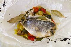 Sea bream in a paper bag Royalty Free Stock Photography