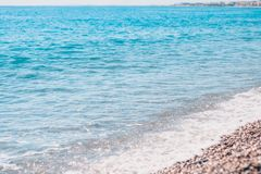 Sea breeze - a beach with pebbles. Against the backdrop of the azure sea stock image