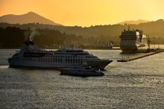 Sea Breeze setting sail in Corfu at sunset Stock Photo