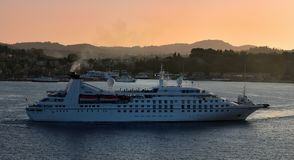 Sea Breeze setting sail in Corfu at sunset Stock Image