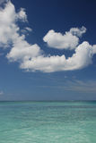 Sea and bright sky at Cayman stock photography