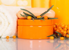 Sea-buckthorn berries and cream, soap, towel Royalty Free Stock Images