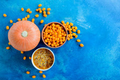 Sea buckthorn berries and jam with pumpkin. Copy space Stock Image