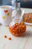 Sea buckthorn jam in a jar. Tasty and healthy Stock Photos