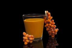 Sea buckthorn juice on black. Stock Photography