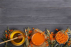 Sea buckthorn juice or tea with honey on a black wooden background with copy space for your text. Top view Stock Photography
