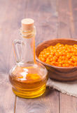 Sea-buckthorn oil and berries Royalty Free Stock Photos
