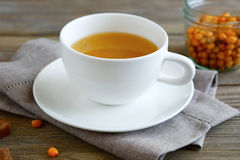 Sea-buckthorn tea in a cup Stock Photo