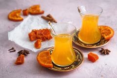 Sea buckthorn tea with honey and candied fruits Royalty Free Stock Images