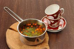 Sea-buckthorn tea with mint in stew-pan Royalty Free Stock Photography