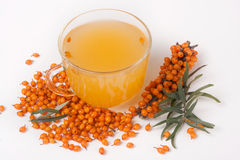 Sea buckthorn tea with a sprig isolated on white background Stock Photo