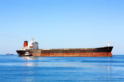 Sea bulk carrier with pilot boat Royalty Free Stock Photo
