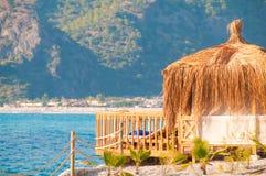 Sea bungalow  on a sand beach Stock Photos