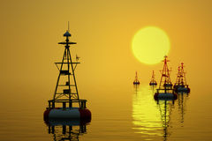 Sea buoys at sunset. Stock Photo