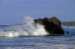 The sea of Caleta de Campos. In the Pacific Ocean waves burst on a rocks in Caleta de Campos, the State of Michoacan, Mexico Stock Photos