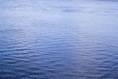 Sea calm. Blue water during sea calm on the whole frame closeup for background Royalty Free Stock Photography