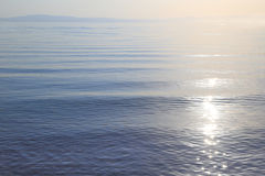Sea calm water. With horizon Stock Images