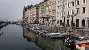 A sea canal in Trieste full of boats stock video footage