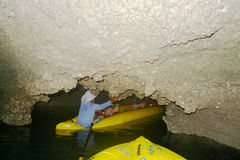 Sea canoe operator bring tourists inside sea caves of Phang  Nga Stock Photography
