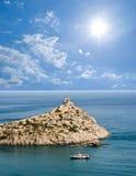 Sea cape  under a sparkle sun Stock Photos