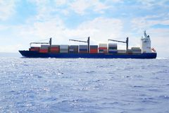 Sea cargo merchant ship sailing blue ocean Royalty Free Stock Photo