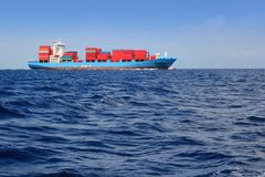 Sea cargo merchant ship sailing blue ocean Stock Photo
