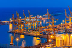 Sea cargo port at night in Barcelona, Spain. Stock Images
