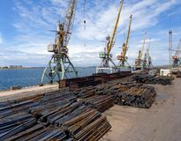 Sea cargo transportations. Cranes in port for loading the metal Stock Image