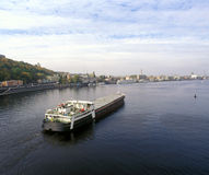 Sea cargo transportations. Cargo ship sailing up the Dnieper river Royalty Free Stock Photos