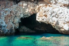 Sea cave on Alanya coast with turquoise water. Stock Photography