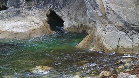 Sea cave at high tide stock video footage