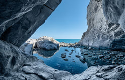 Sea cave rocks. Grotto with water reflections. Italy royalty free stock photo