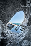 Sea cave rocks. water reflections. Sea cave rocks. Grotto water reflections royalty free stock images
